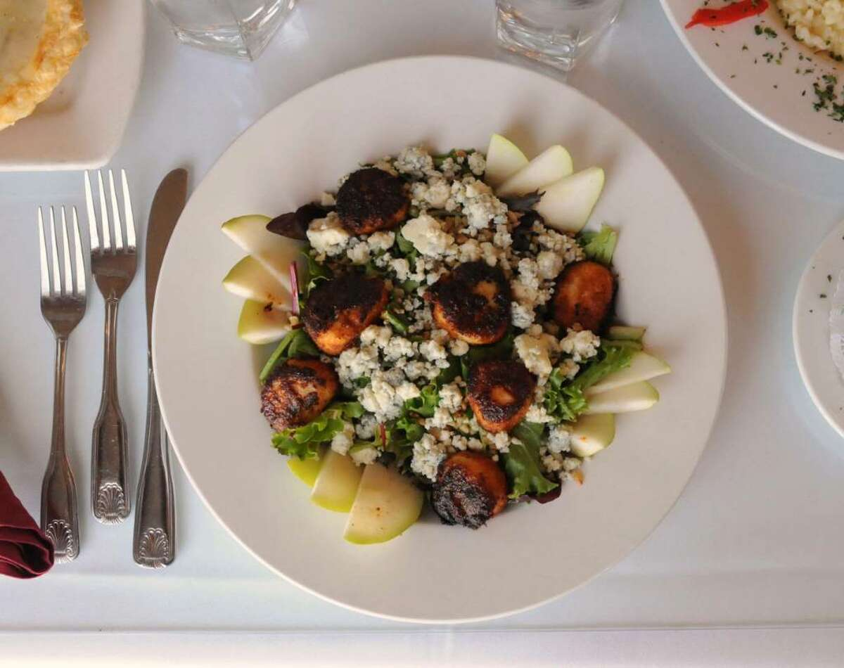 A favorite at The Putnam House Restaurant in Bethel, CT. Pear and Walnut Salad with Blackened Scallops. Tuesday Oct. 21, 2009.