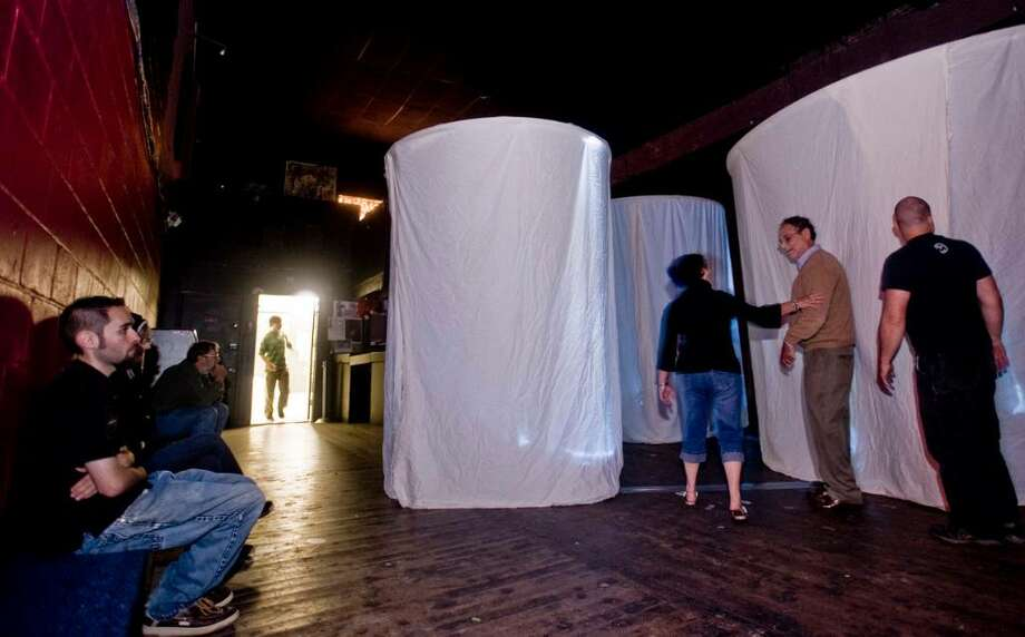 "Visitors of the Heirloom Arts Theater on Main Street listen to the sounds and walk around the fabric cylinders of the ""MB 89"" exhibit by Craig Colorusso. Saturday, Sept. 19, 2009 Photo: Scott Mullin / The News-Times"