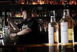 Broken Record owner Jason King preparing a boilermaker on Wednesday, December 22, 2010, at his bar in San Francisco, Calif. The boilermaker he is making is made from Trumer Pilsner with the highland-malt whisky An Cnoc