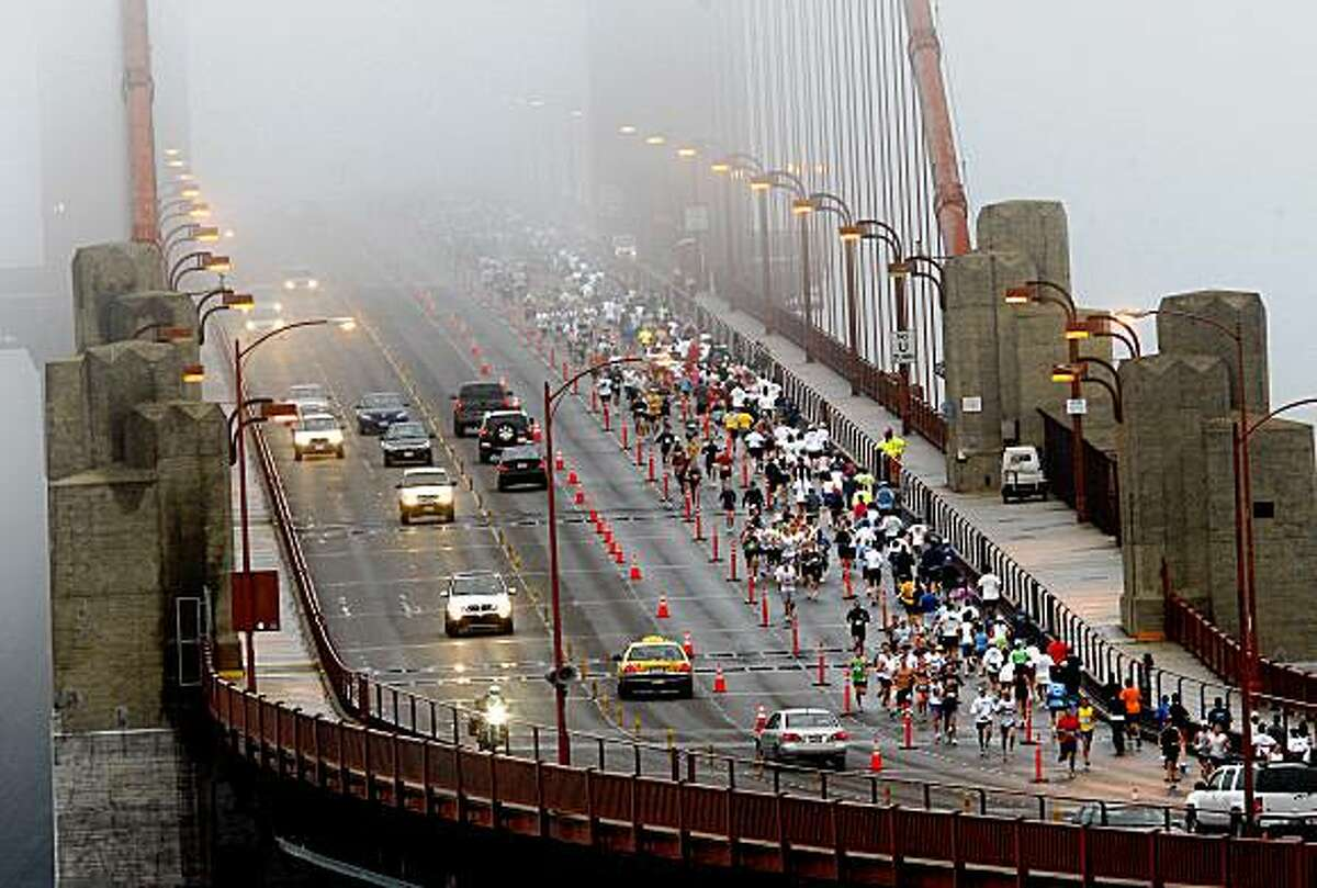Runners used the northbound lanes to cross the foggy Golden Gate Bridge and then returned. More than 20,000 runners circled the city for the annual San Francisco Marathon Sunday July 26, 2009.