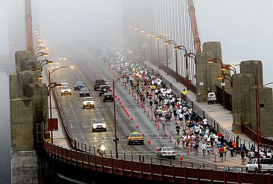 Runners used the northbound lanes to cross the foggy Golden Gate Bridge and then returned. More than 20,000 runners circled the city for the annual San Francisco Marathon Sunday July 26, 2009. Photo: Brant Ward, The Chronicle