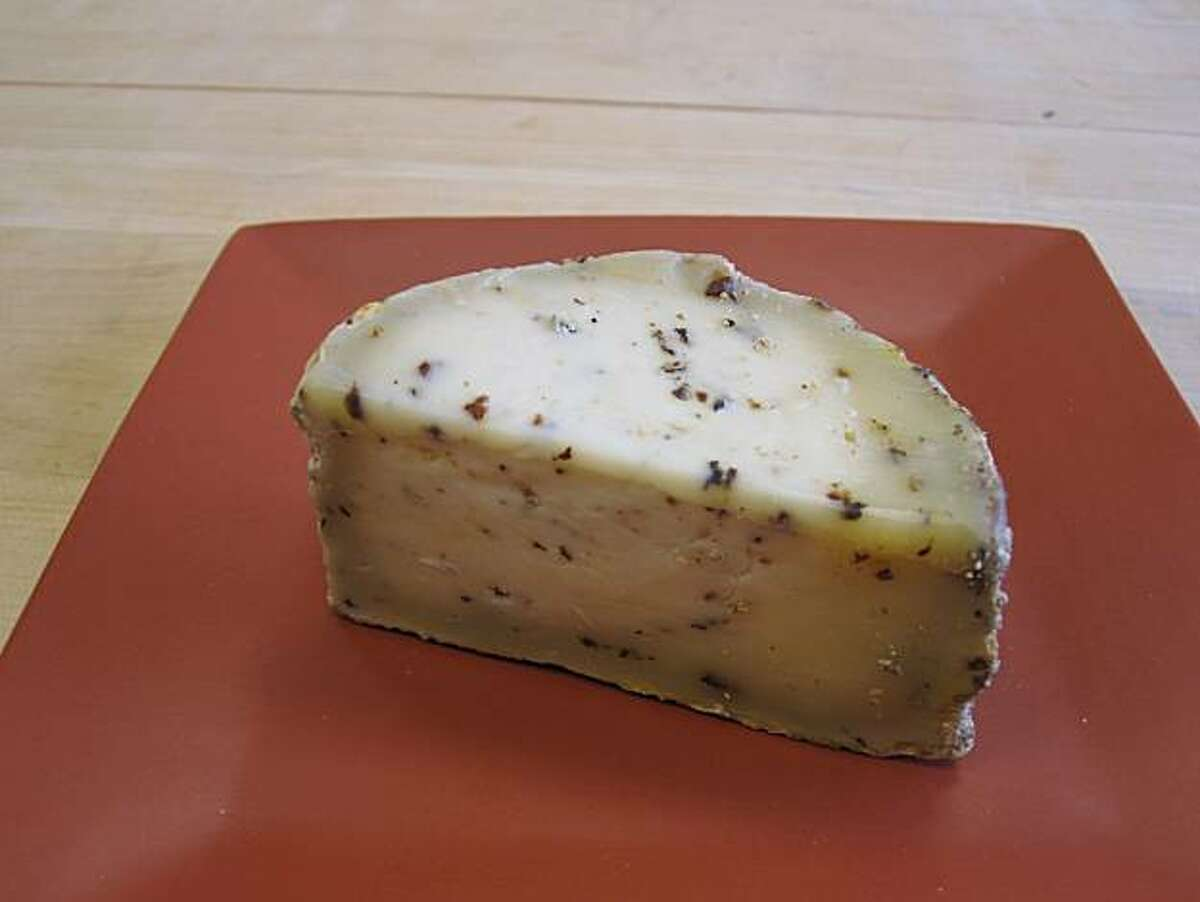 Juni, an aged cow's milk cheese perfumed with juniper berries.