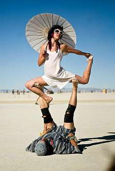 Participants perform a routine of strength and endurance on the open playa during Burning Man 2010 in Black Rock City, Nev.  Photo: Vince Alonzo, The Reno Gazette-Journal