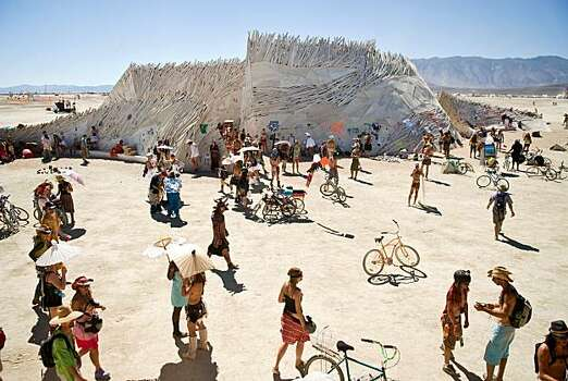 "Burners congregate around ""The Temple of Flux,"" a spiritual place for many at Burning Man 2010.  Photo: Vince Alonzo, AP"