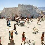 "Burners congregate around ""The Temple of Flux,"" a spiritual place for many at Burning Man 2010."