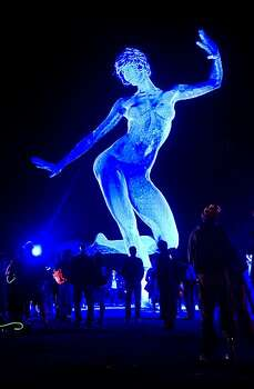 "Attendees admire Marco Cochrane's ""Bliss Dance"" during Burning Man 2010 in Black Rock City, Nev.  Photo: Vince Alonzo, AP"