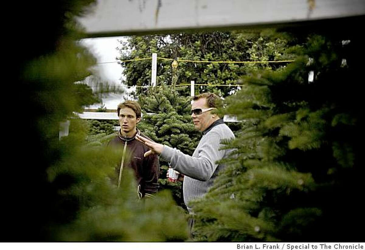Dan Canale of San Francisco picks out his Christmas tree at The Educated Tree Christmas tree lot located at Marina Middle School. Canale's tree was the first bought at the lot on the day following Thanksgiving.