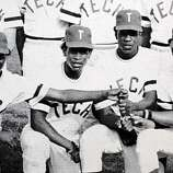 Rickey Henderson (second from left) and some of his Oakland Tech Bulldog baseball teammates appear in a yearbook team photo in Henderson's junior year in Oakland, Calif.
