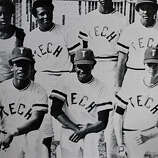 Rickey Henderson (bottom left) poses for a team photo with Oakland Tech Bulldog teammates in his senior year in Oakland, Calif.