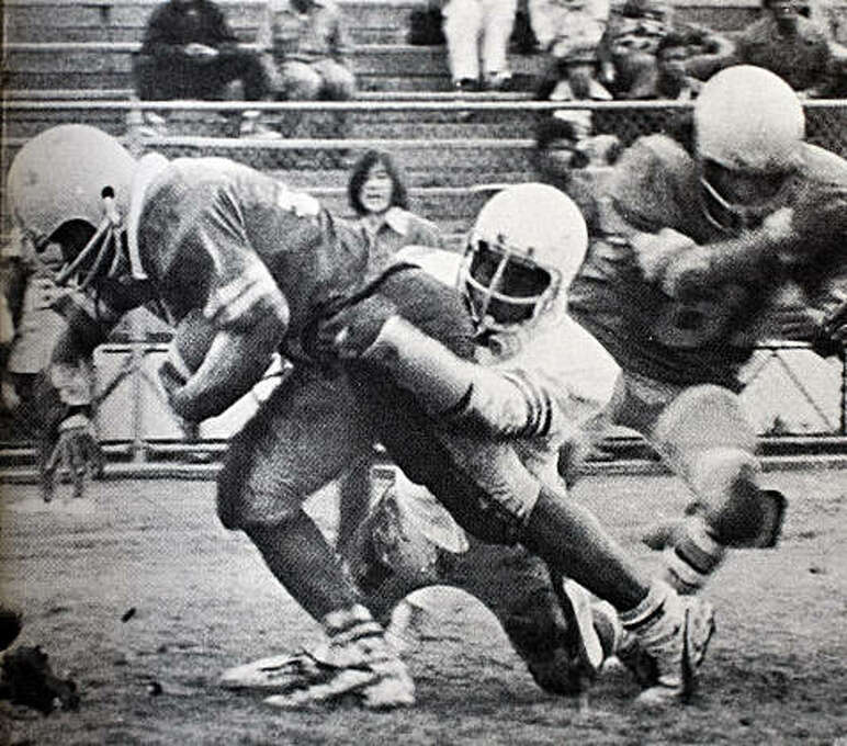 Rickey Henderson gains yardage as a halfback for the Oakland Tech Bulldogs in his senior year as a star high school athlete in Oakland, Calif. Photo: Oakland Technical High School