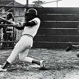 A yearbook photo shows Oakland Tech High School star athlete Rickey Henderson slap a base hit in his senior year in Oakland, Calif., on Friday, July 17, 2009.