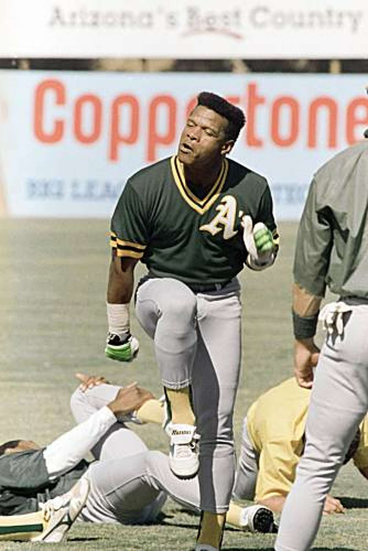 Oakland A's outfielder Rickey Henderson stomps out a World Series dance step during warm up exercise for practice in Phoenix, Thursday, Oct. 26, 1989. The A's are at their spring training site to workout for the resumption of the World Series against the San Francisco Giants, which continues Friday night.