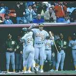 1989:  Outfielders Rickey Henderson and Jose Canseco of the Oakland Athletics celebrate during a playoff game against the San Francisco Giants at Candlestick Park in San Francisco, California.  Mandatory Credit: Otto Greule  /Allsport