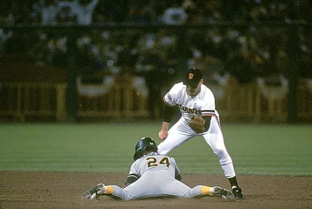 SAN FRANCISCO - OCTOBER: Infielder Matt Williams #9 of the San Francisco Gaints attempts to tag Rickey Henderson #22 of the Oakland Athletics during the 1989 World Series at Candlestick Park in San Francisco, California, in October. (Photo by Otto Greule Jr/Getty Images)