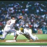 Oct 1989:  First baseman Will Clark of the San Francisco Giants tries to tag out outfielder Rickey Henderson of the Oakland Athletics during the World Series at the Oakland Coliseum in Oakland, California. Mandatory Credit: Otto Greule/Allsport