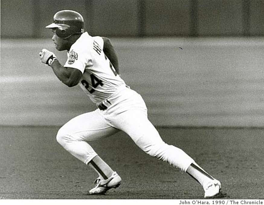 Rickey Henderson, in pursuit of the Major League stolen base record. 1990. Photo: John O'Hara, The Chronicle