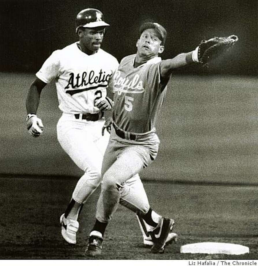 1990: Mike Gubicza threw a ball to George Brett at first base when Rickey Henderson was leading off it in the third inning. Brett almost misplayed the throw. Photo: Liz Hafalia, The Chronicle