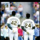 1991:  Outfielders Dave Henderson (left) and Rickey Henderson of the Oakland Athletics stand with backs to camera. Mandatory Credit: Otto Greule  /Allsport