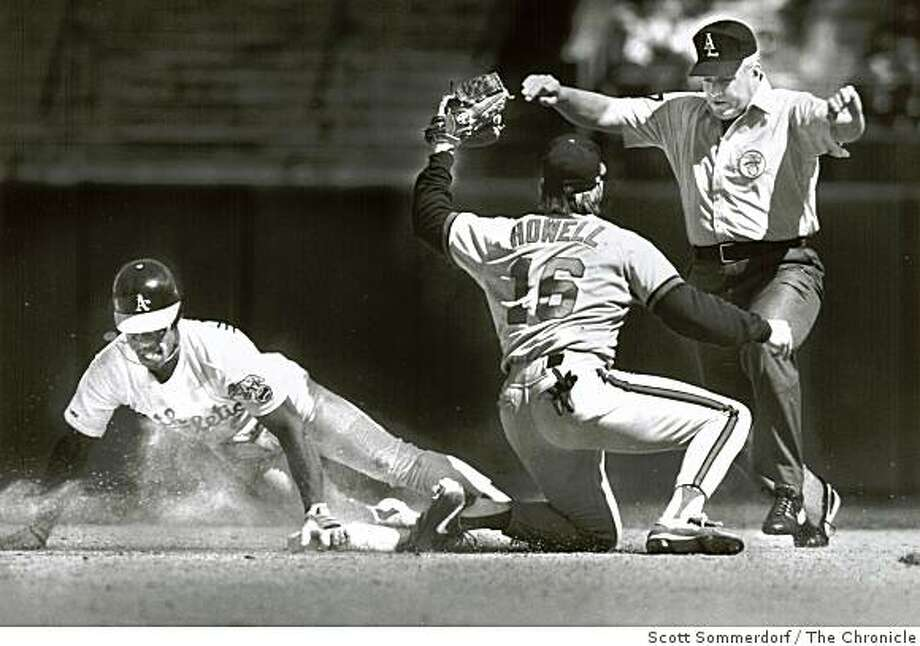 April 28, 1991 - Umpire Drew Coble calls Rickey Henderson safe after he stole second base in the second inning. The Angel who applied the late tag is Jay Howell.  Scott Sommerdorf/San Francisco Chronicle Photo: Scott Sommerdorf, The Chronicle