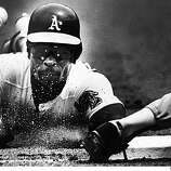 A's Rickey Henderson slides into base.