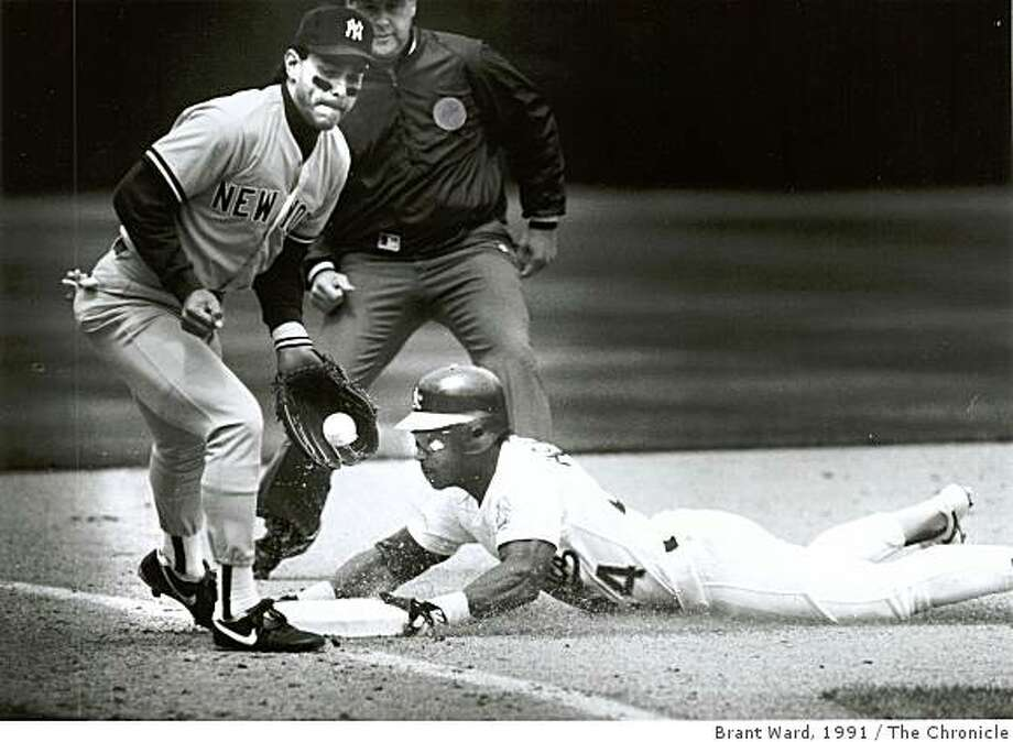 HENDERSON_HALL08.jpg May 1, 1991Rickey Henderson breaks the all time base stealing record as he slides into 3rd base wed. Photo: Brant Ward, 1991, The Chronicle