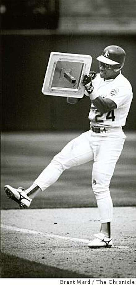 1991: Rickey Henderson, breaks the stolen base record. He picked up 3rd base to take it home. Photo: Brant Ward, The Chronicle