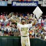 ** FILE ** In this May 1, 1991, file photo, Oakland Athletics' Rickey Henderson celebrates and raises third base after setting the all-time stolen base record during the Athletics' baseball game in Oakland, Calif., against the New York Yankees. The stolen base was Henderson's 939th, moving him past Lou Brock. Henderson was voted into baseball's Hall of Fame on Monday, Jan. 12, 2009. (AP Photo/Eric Risberg, File)