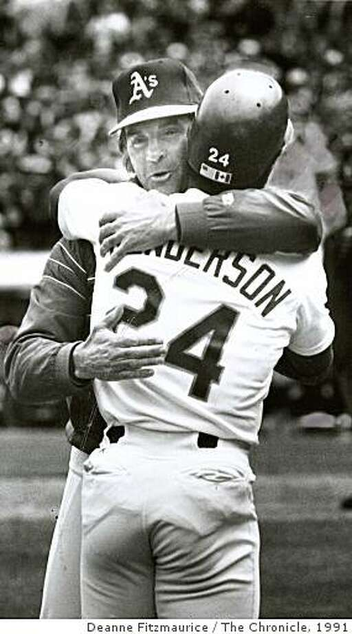 1991: Rickey Henderson gets a hug from Mgr. Tony LaRussa after surpassing Lou Brock's base stealing record at Coliseum against Yankees. Photo: Deanne Fitzmaurice, The Chronicle