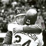 May 1, 1991 Rickey Henderson gets a hug from Mgr. Tony LaRussa after surpassing Lou Brock's base stealing record at Coliseum against Yankees.
