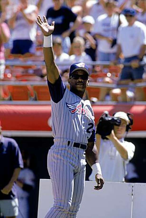 SAN DIEGO - AUGUST 28:  Rickey Henderson #24 of the Anaheim Angels waves to the fans during a game with the San Diego Padres at Qualcomm Stadium on August 28, 1997 in San Diego, California.  The Padres won 3-2.  (Photo by Jed Jacobsohn/Getty Images) Photo: Jed Jacobsohn, Getty Images
