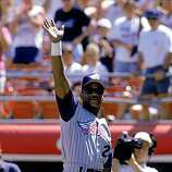 SAN DIEGO - AUGUST 28:  Rickey Henderson #24 of the Anaheim Angels waves to the fans during a game with the San Diego Padres at Qualcomm Stadium on August 28, 1997 in San Diego, California.  The Padres won 3-2.  (Photo by Jed Jacobsohn/Getty Images)