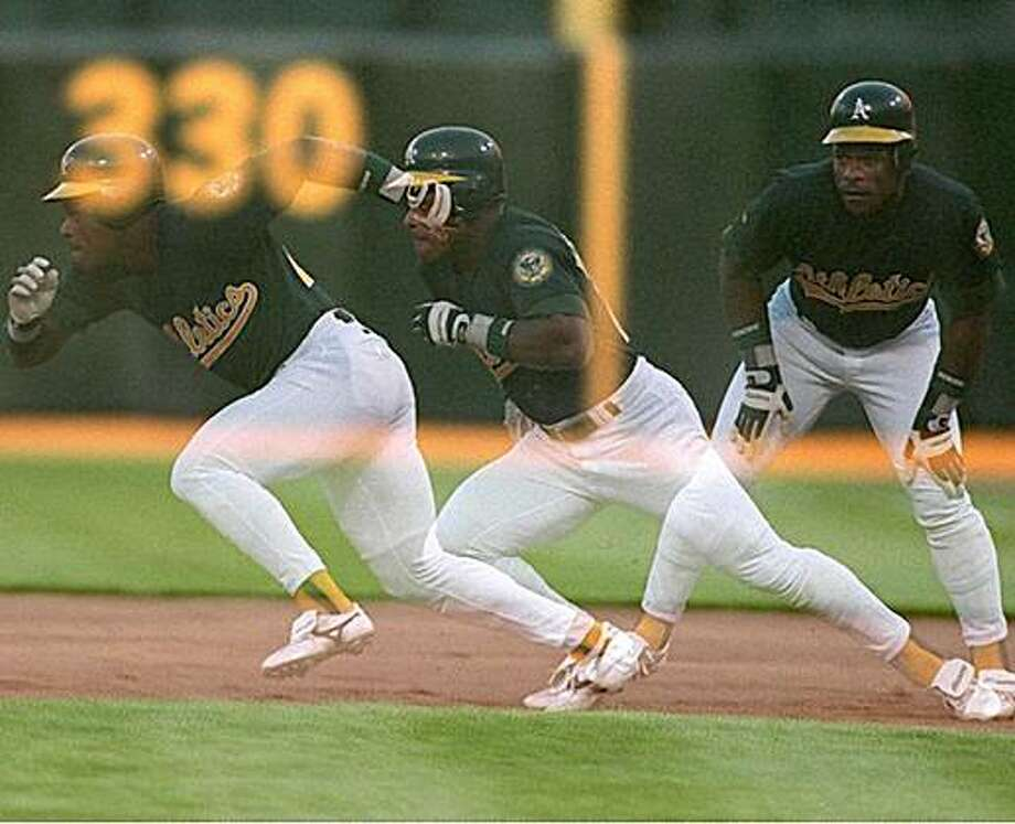 1995: Rickey Henderson gets his jump off of first base on his way to stealing second base in the first inning of the 8-2 loss against the Milwaukee Brewers at the Oakland Coliseum on July 5, 1995. Photo: Brad Mangin, Special To The Chronicle