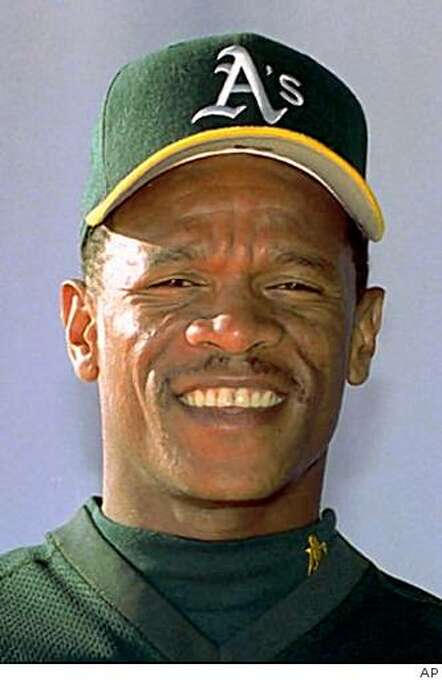 ** FILE ** This is a 1995 file photo showing Oakland Athletics baseball player Rickey Henderson. Henderson sped his way into the Hall of Fame on the first ballot Monday, Jan. 12, 2009, and Jim Rice made it in on his 15th and final try. (AP Photo/File) Photo: AP