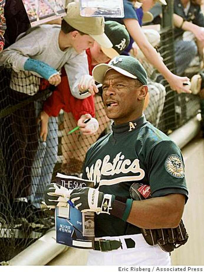ADVANCE FOR WEEKEND OF MARCH 28-29--FILE--Oakland Athletics left fielder Rickey Henderson looks out to the field from the clubhouse walkway prior to the A's spring training game against the Chicago White Sox in Phoenix, Ariz., March 6, 1998. The 39-year-old all-star is playing with the Athletics for the fourth time in his career. (AP Photo/Eric Risberg) Photo: Eric Risberg, Associated Press