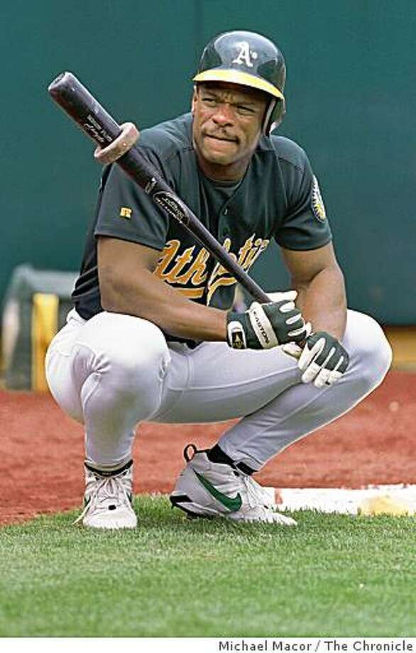 A'S HENDERSO31/C/30JUN98/SP/MAC Oakland A's Rickey Henderson, waits on the on-deck circle for his at bat. By Michael Macor Photo: Michael Macor, The Chronicle
