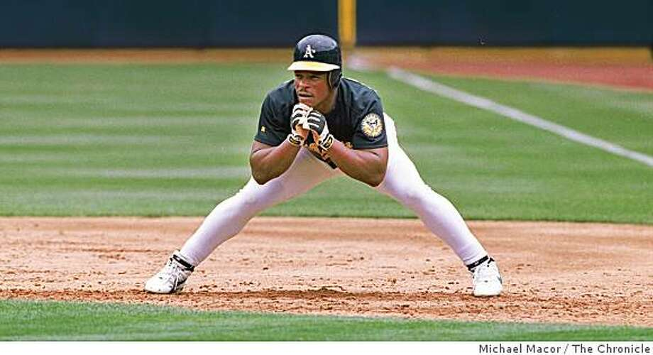 Oakland A's Rickey Henderson, takes a signature lead off at first base. Photo: Michael Macor, The Chronicle