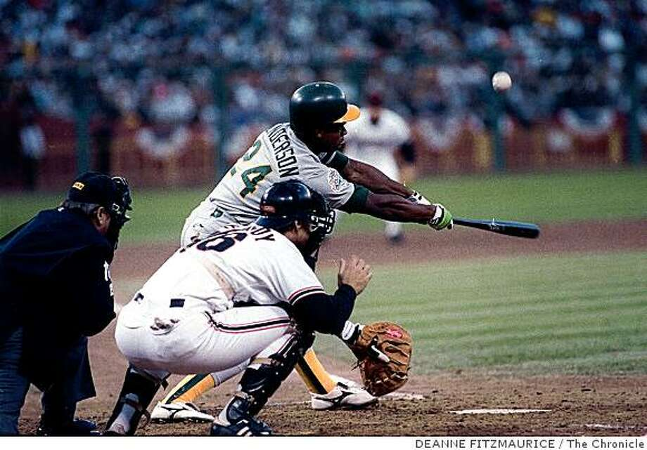 A's Rickey Henderson makes contact during game four of the 19989 World Series. KENNY is behind the plate for the Giants. Photo: DEANNE FITZMAURICE, The Chronicle