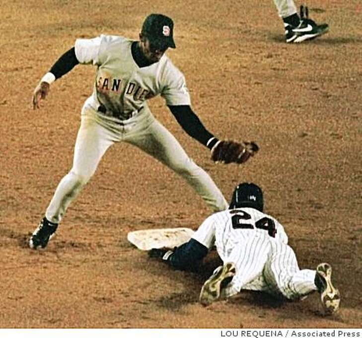 New York Mets' Rickey Henderson slides into second base with his 1300th career stolen base as San Diego Padres second baseman Damion Jackson makes a late tag in the third inning Tuesday, April 27, 1999 at Shea Stadium in New York. Photo: LOU REQUENA, Associated Press