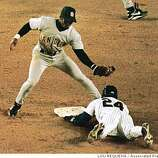 New York Mets' Rickey Henderson slides into second base with his 1300th career stolen base as San Diego Padres second baseman Damion Jackson makes a late tag in the third inning Tuesday, April 27, 1999 at Shea Stadium in New York.