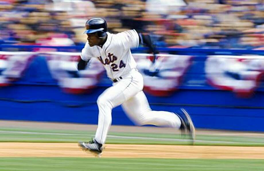 1999:  Outfielder Rickey Henderson of the New York Mets attempts a steal of second base during the game against the Florida Marlins at Shea Stadium in Flushing Meadow, New York. The Mets defeated the Marlins 8-1. Photo: Ezra Shaw, Getty Images