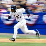 12 Apr 1999:  Outfielder Rickey Henderson #24 of the New York Mets attempts a steal of second base during the game against the Florida Marlins at Shea Stadium in Flushing Meadow, New York. The Mets defeated the Marlins 8-1. Mandatory Credit: Ezra O. Shaw/Allsport