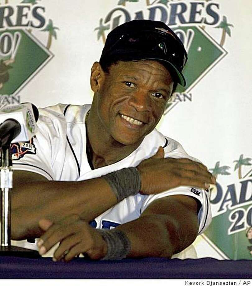 In this Oct. 4, 2001 file photo, San Diego Padres' Rickey Henderson sports the big smile at a news conference following the Padres' 6-3 victory over the Los Angeles Dodgers in San Diego. Henderson scored his 2,246 career run on a solo home run in the third inning of the game, breaking the all-time mark he shared with Ty Cobb. Photo: Kevork Djansezian, AP