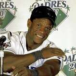 In this Oct. 4, 2001 file photo, San Diego Padres' Rickey Henderson sports the big smile at a news conference following the Padres' 6-3 victory over the Los Angeles Dodgers in San Diego. Henderson scored his 2,246 career run on a solo home run in the third inning of the game, breaking the all-time mark he shared with Ty Cobb.