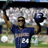 In this Oct. 7, 2001 file photo, San Diego Padres' Rickey Henderson waves to the crowd after collecting his 3,000th career hit during the first inning of the Padres' game against the Colorado Rockies in San Diego.