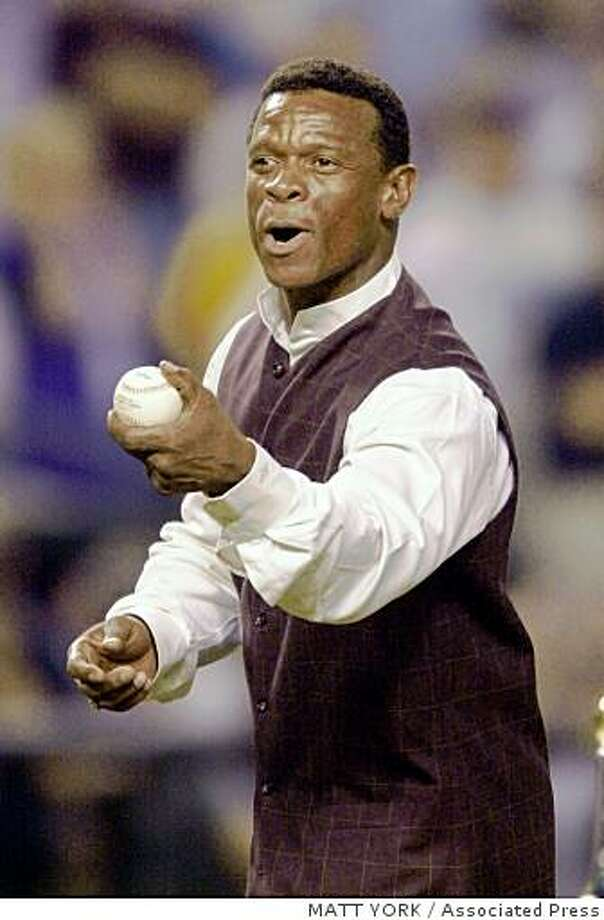 San Diergo Padres' Rickey Henderson throws out the ceremonial first pitch before Game 2 of the World Series between the New York Yankees and Arizona Diamondbacks Sunday, Oct. 28, 2001, at Bank One Ballpark in Phoenix. (AP Photo/Mike Blake) Photo: MATT YORK, Associated Press