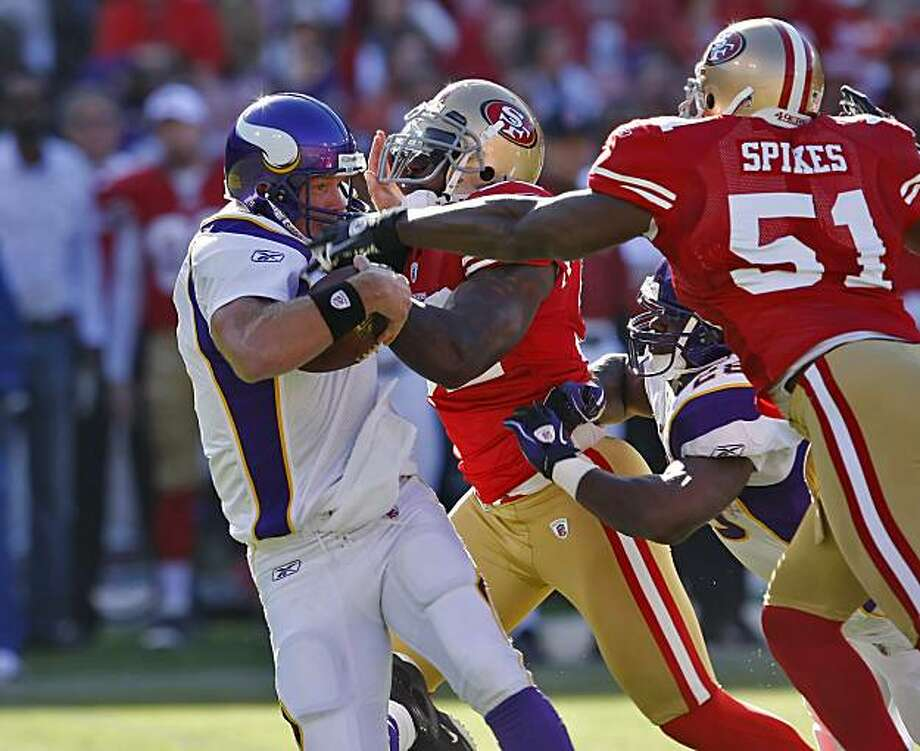 Minnesota Vikings quarterback Brett Favre gets sacked by San Francisco 49ers defense in the first period in the first quarter of the game  in a pre-season game, Sunday August 22, 2010, in San Francisco, Calif. Photo: Lacy Atkins, The Chronicle