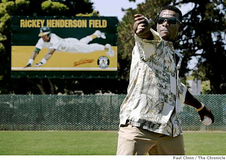 2006: Rickey Henderson throws out the first pitch at the dedication ceremony for Rickey Henderson Field at the Arroyo Viejo Recreation Center in Oakland, Calif. on Friday, August 11, 2006. The former Oakland A's star and future Hall of Famer is an Oakland native. Photo: Paul Chinn, The Chronicle