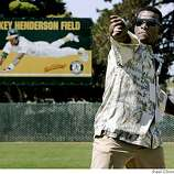 Rickey Henderson throws out the first pitch at the dedication ceremony for Rickey Henderson Field at the Arroyo Viejo Recreation Center in Oakland, Calif. on Friday, August 11, 2006. The former Oakland A's star and future Hall of Famer is an Oakland native.PAUL CHINN/The Chronicle