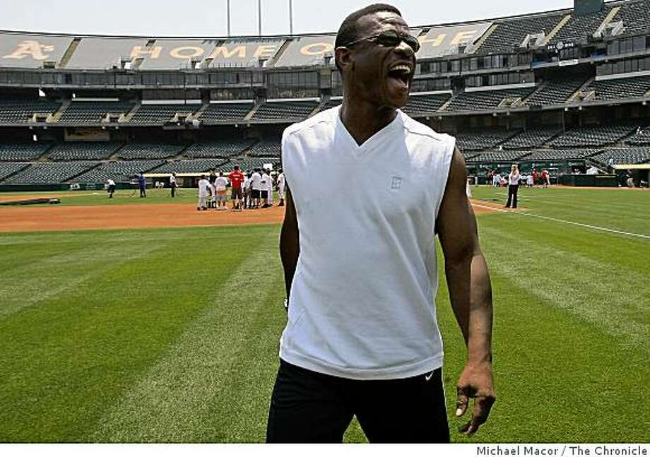 Former Oakland Athletic  star, Rickey Henderson, takes the field once again at McAfee Coliseum in Oakland, Calif., for the Bank of America Youth Baseball Clinic on Tuesday JUly 8, 2008 to share his skills with kids from the Oakland Babe Ruth Baseball league.Photo By Michael Macor/ The Chronicle Photo: Michael Macor, The Chronicle