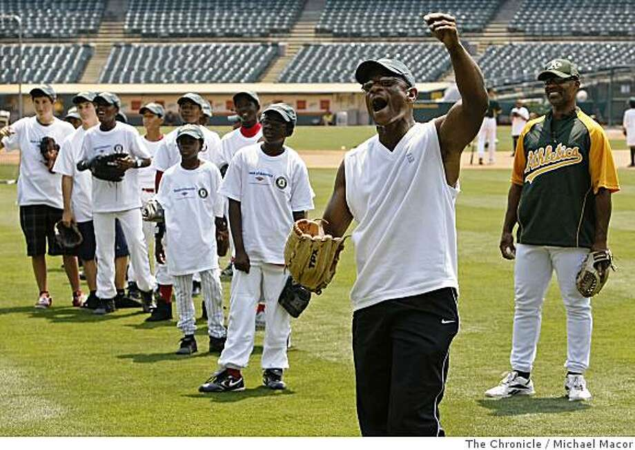 Former Oakland Athletic star, Rickey Henderson, cheers a catch as he tosses pop-ups to kids during the Bank of America Youth Baseball Clinic at the McAfee Coliseum in Oakland, Calif. on Tuesday July 8, 2008.Photo By Michael Macor/ The Chronicle Photo: Michael Macor, The Chronicle